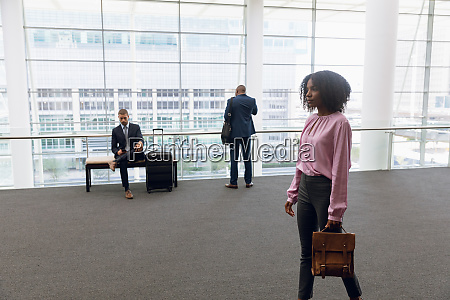 diverse business travallers waiting