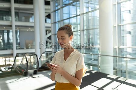 businesswoman using smartphone at work