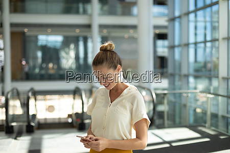 businesswoman using smartphone at work