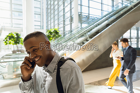 young businessman talking on smartphone in