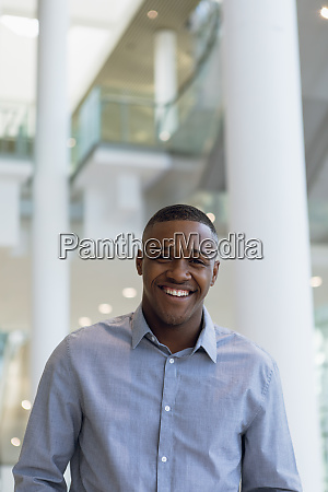 smiling businessman in modern business building