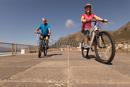senior couple riding a bicycle on