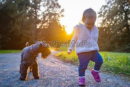 happy child with their dog black