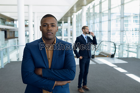 two businessmen standing in the lobby