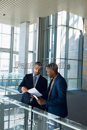 two businessmen talking standing in the