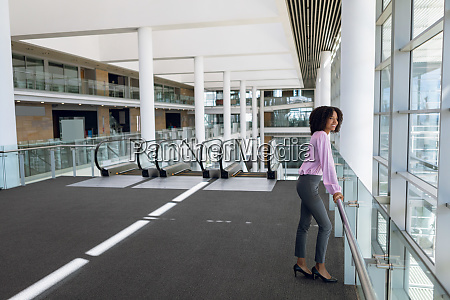 young businesswoman standing in a modern