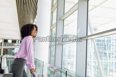 young businesswoman looking out of window