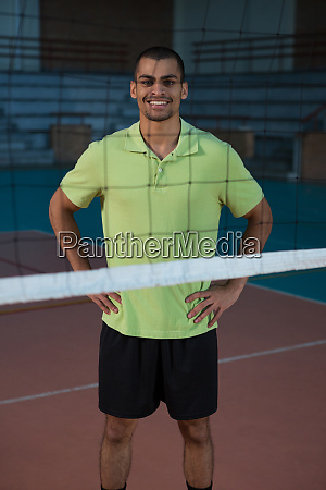 portrait of smiling volleyball player standing