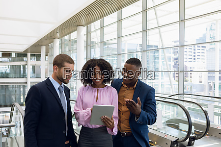 diverse young business people using tablet