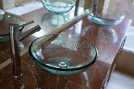 glass sinks with steel taps installed