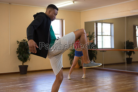 side view of dancer practicing in