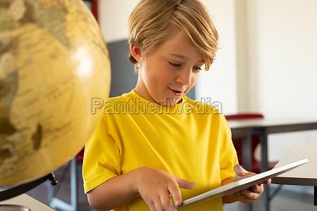 boy using digital tablet in a