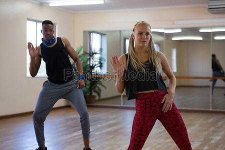 dancers rehearsing against mirror on floor