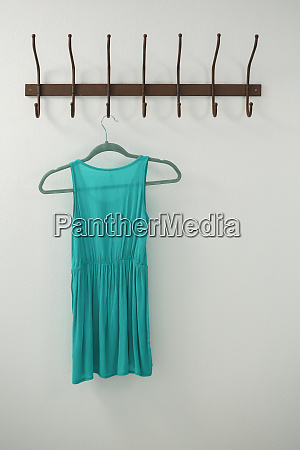 turquoise dress hanging on hook