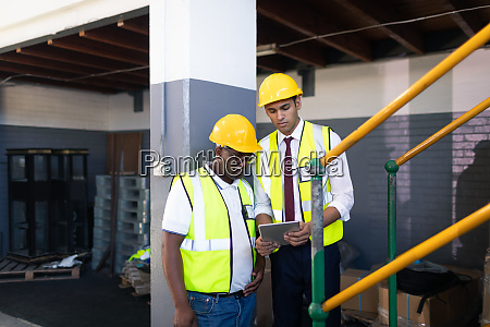 male supervisor with his coworker discussing