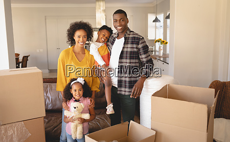 happy african american family with cardboard