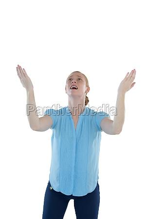 female executive gesturing against white background