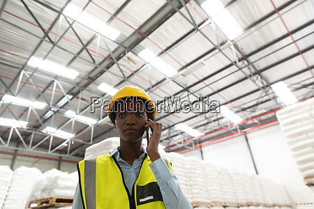 female worker talking on mobile phone