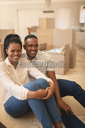 happy african american couple sitting on