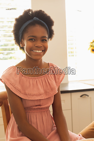 happy african american girl looking at