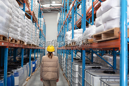 female worker standing in warehouse