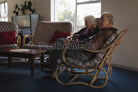 senior couple relaxing on chair at