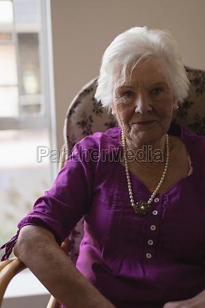 senior woman looking at camera in
