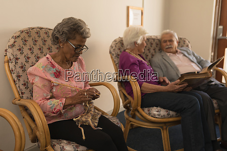 senior friends knitting and looking photo