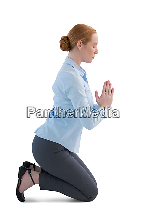 businesswoman kneeling in prayer position