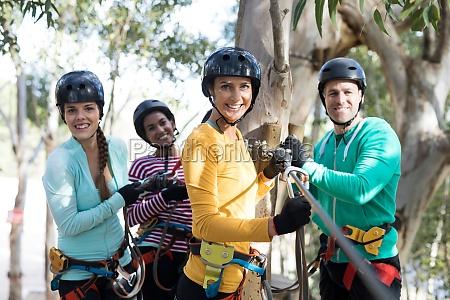 friends enjoying zip line adventure in