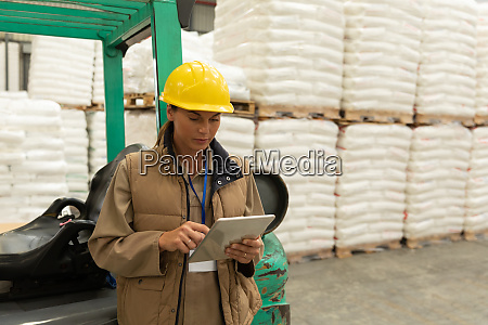 female worker using digital tablet in
