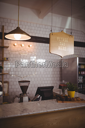 text and pendant light hanging over