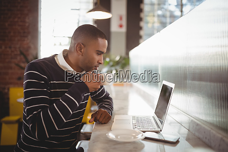side view of young man drinking