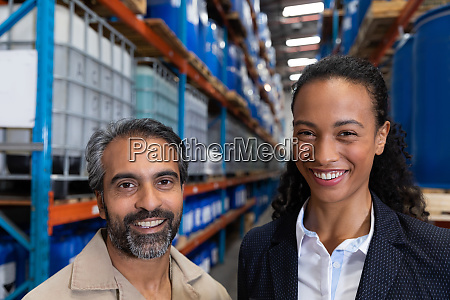 female manager standing together in warehouse