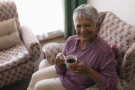 senior woman having black coffee in