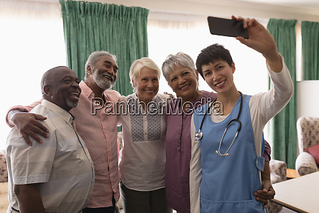 senior people and female doctor taking
