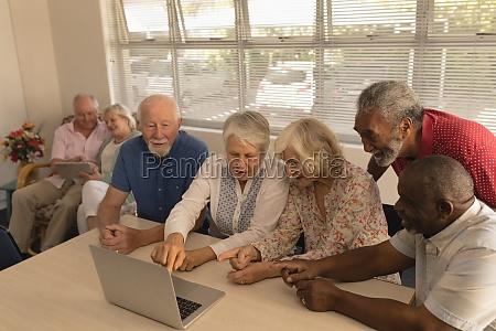 group of senior people using laptop