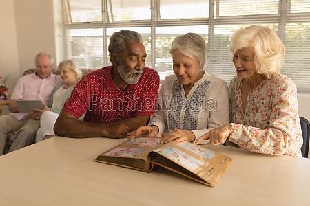 group of senior people looking at