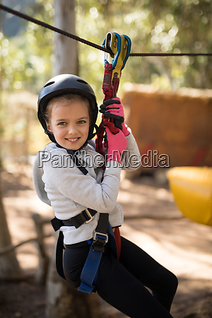 cute girl enjoying zip line adventure