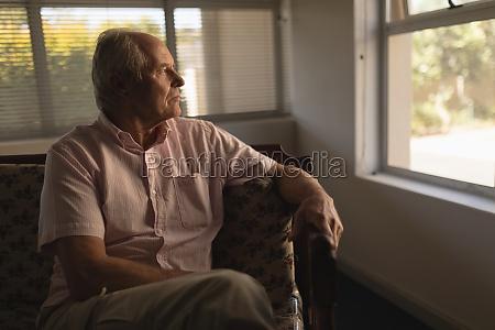 senior man relaxing in living room