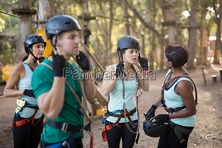 coach and trainee wearing protective helmet