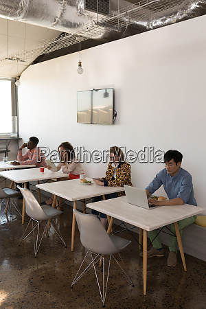 business colleagues using multimedia devices in