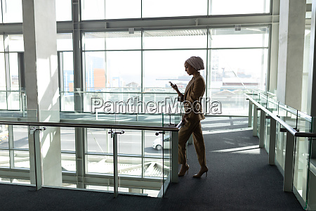 side view of businesswoman using mobile