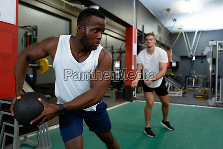 male athletics exercising with exercise ball