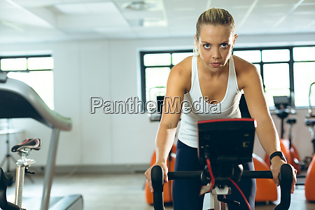 woman exercising with exercise bike in
