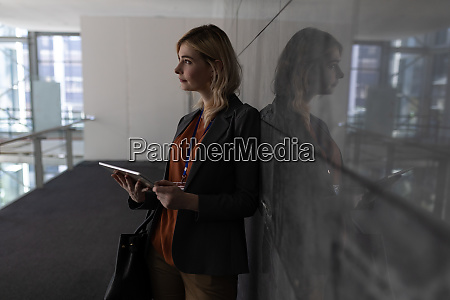 young caucasian businesswoman with coffee cup