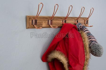 warm clothing hanging on hook
