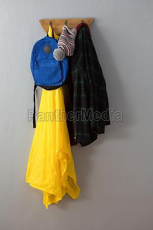 raincoat warm clothing and bag hanging