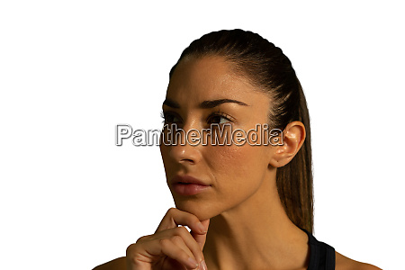 young businesswoman touching her chin and
