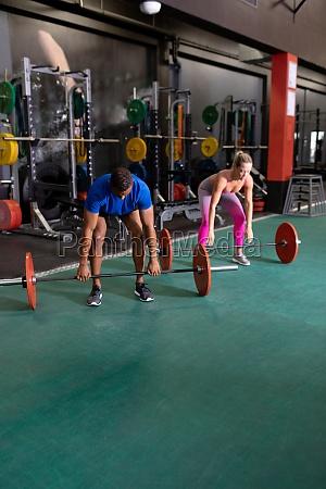 man and woman lifting